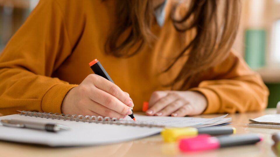 Girl using a marker pen